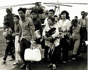 South Vietnamese refugees walk across a U.S. Navy vessel during Operation Frequent Wind. Via Wikimedia Commons