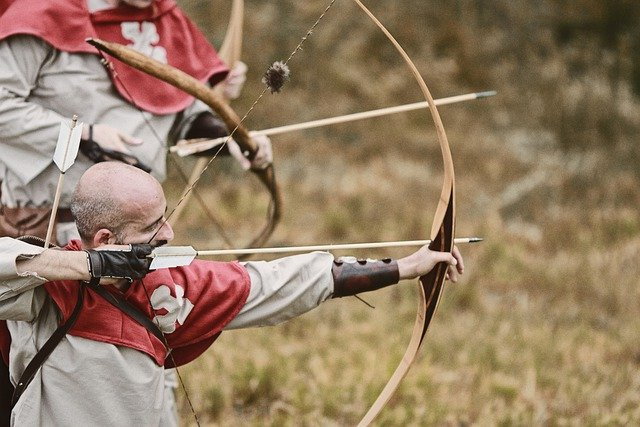 Recreation of an archer using a longbow.