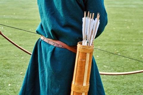 Quiver with arrows on medieval archer's back.